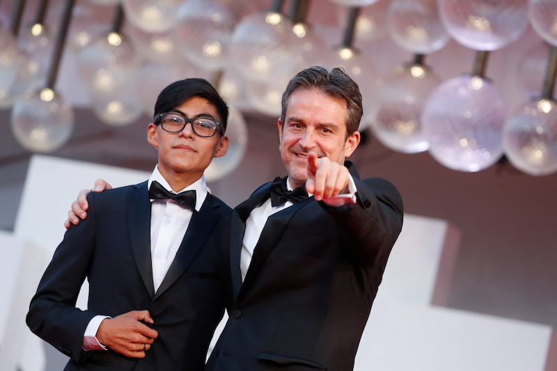 Director Lorenzo Vigas and actor Hatzin Navarrete pose at the screening of the film 'The Box' in Venice, Italy September 6, 2021. — Reuters pic