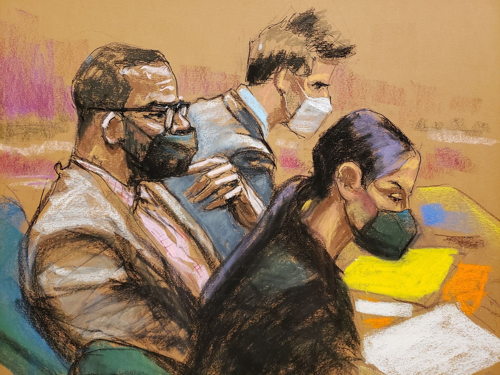 R. Kelly sits in court between his attorneys Thomas Farinella and Nicole Blank Becker during his sex abuse trial at Brooklyn's Federal District Court in a courtroom sketch in New York September 1, 2021. ― Reuters pic