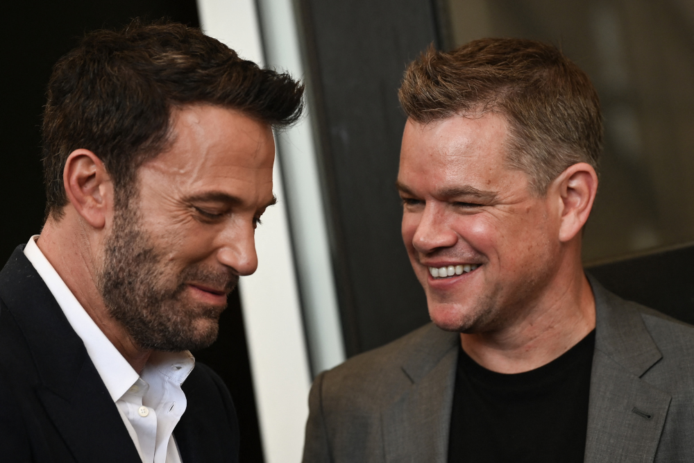 Ben Affleck and Matt Damon attend a photocall for the film 'The Last Duel' presented out of competition during the 78th Venice Film Festival at Venice Lido, September 10, 2021. — AFP pic