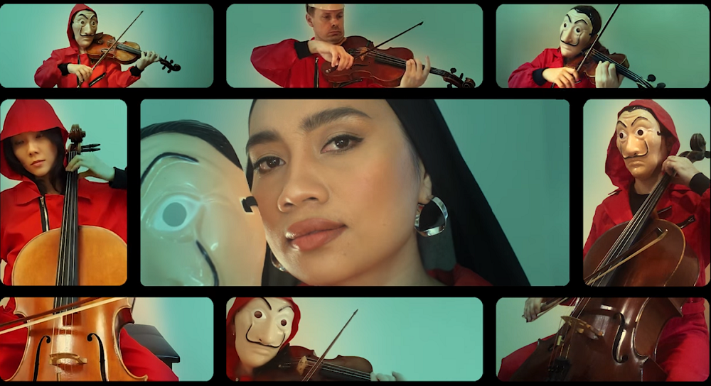 Local singer, Yuna along with the Malaysian Philharmonic Orchestra has collaborated to perform the iconic 'Bella Ciao' song from the anticipated Netflix's show, 'Money Heist'. ― Screenshot from Facebook/ Netflix MY