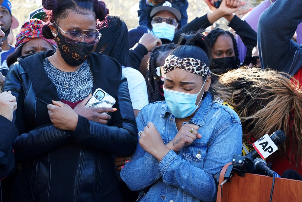 Rapper DMX's fiancé Desiree Lindstrom (right) and ex-wife Tashera Simmons (left) attend a vigil for the rapper outside a hospital in White Plains, New York April 5, 2021. — Reuters pic