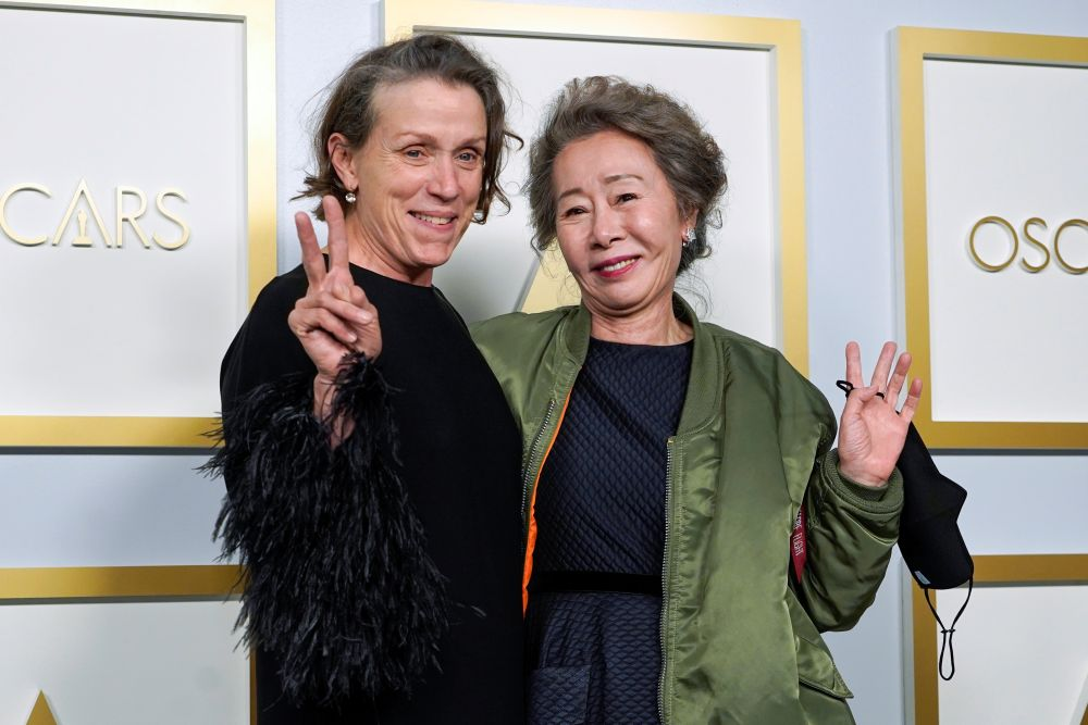 Frances McDormand (left) and Youn Yuh-Jung pose in the press room at the Oscars, in Los Angeles April 25, 2021. — Reuters pic