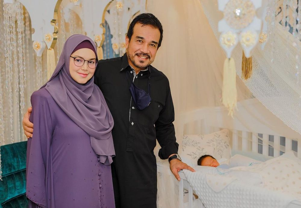 Siti and her husband Datuk K at their newborn son's tahnik ceremony on April 26. — Picture from Instagram/@ctdk