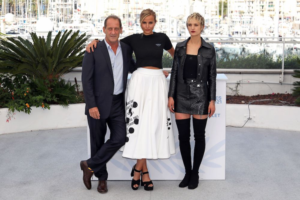 Director Julia Ducournau and cast members Vincent Lindon and Agathe Rousselle pose during the photocall for the film 'Titane' at the The 74th Cannes Film Festival in Cannes, July 14, 2021. — Reuters pic